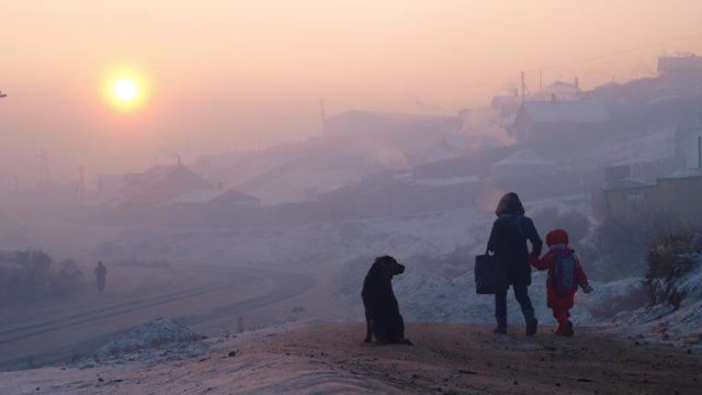 Children in Ulaanbaatar's smoggy streets at dawn